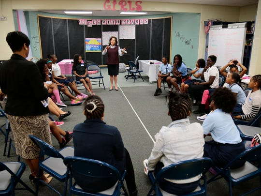 Volunteer Tamie Sullivan talks about self esteem as a topic of the day during an after school meeting of Girls With Pearls  at Rockdale Academy in the Avondale neighborhood of Cincinnati on Wednesday, May 4, 2016. Girls With Pearls meetings focus on main tenants of Personal Responsibility, Empathy, Awareness, Respect, Leadership and Support.