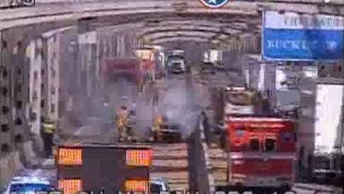 Memphs police and fire respond to a car fire on I-55 bridge Tuesday morning. Southbound traffic was blocked as crews worked to put out the fire.