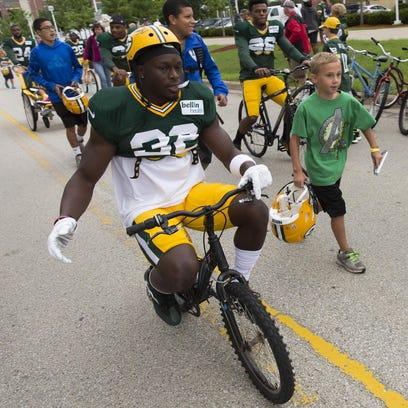 Packers cornerback Chris Banjo rides a bike to practice.