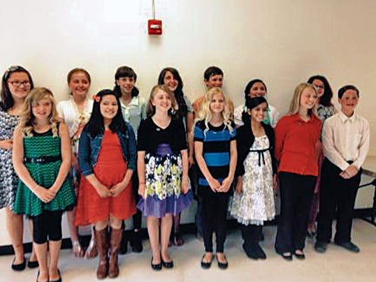 Students initiated into the National Junior Honor Society: Top row from left — Andrea Chavez, Emma Renner, Hannah Carlsen, Mercedes Hazen, Garrison Weems, Estrella Sedillo, Melena Proctor. Bottom row from left — Jaden Wooddell, Elsa Sanchez, Kelby Hightower, Caitlin Daugherty, Sanjna Suren, Courtney Baxter, Sam Watts.