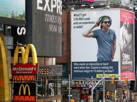 A billboard about raising the state minimum wage to