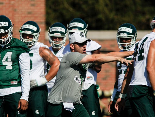MSU Co-Defensive Coodinator Mike Tressel works with