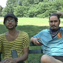 """In this July 13 video frame grab, Jordan Clark, left, and Lewis Gutierrez talk about their """"Pokemon Go"""" service in the Prospect Park area of the Brooklyn borough of New York. They are among the entrepreneurs who offer to be game """"trainers"""" at $20 an hour — logging on to a client's """"Pokemon Go"""" account and running up the score."""