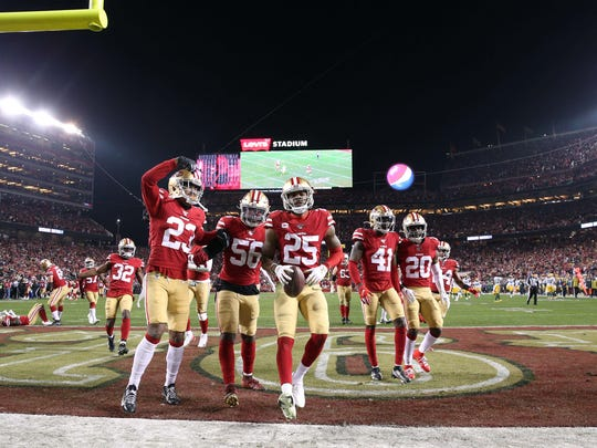 Jan 19, 2020; Santa Clara, California, USA; San Francisco 49ers cornerback Richard Sherman (25) celebrates with teammates after intercepting a pass against the Green Bay Packers during the second half in the NFC Championship Game at Levi's Stadium. Mandatory Credit: Cary Edmondson-USA TODAY Sports