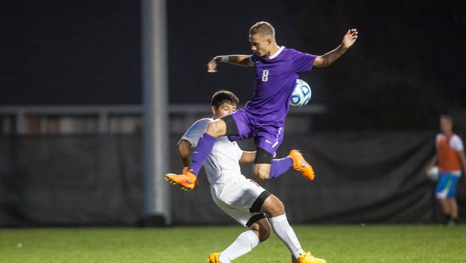 Central's Aaron Green plays a ball in the air against Jay County in the boys 2015 soccer sectional at the Yorktown Sports Complex. Jay County won 2-1.