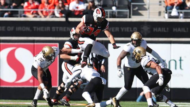 Oct 14, 2017; Corvallis, OR, USA; Oregon State Beavers running back Ryan Nall (34) leaps over the Colorado Buffaloes defense at Reser Stadium. Mandatory Credit: Scott Olmos-USA TODAY Sports