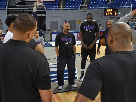 Reno Bighorns head coach Darrick Martin, center, huddles up with his team at the start of the practice at Lawlor Events Center on March 30.