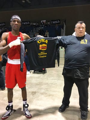Poughkeepsie's Dominique Crowder poses with his trainer after winning the Western Elite Qualifier boxing tournament in New Mexico.