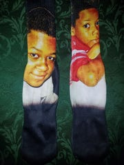 Dylan Ozene's socks show a picture of him with his brother Shane, who died seven years ago while playing basketball.