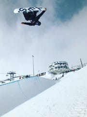 Mountain Home's Mike Slaughter took this photo of Canada snowboarder Derek Livingston competing recently in Laax, Switzerland. Slaughter will coach the men's and women's halfpipe teams for Canada in the Winter Olympics, which begin Thursday in South Korea.
