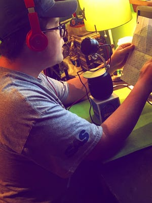 """Ontario junior Justin Reed records his song, """"Champions"""" he wrote about the Ontario Warriors baseball team's 22-game winning streak."""