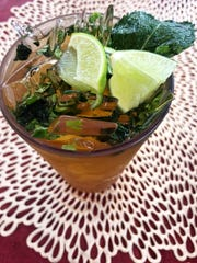 Mojita papelón, a drink made with brown cane sugar,