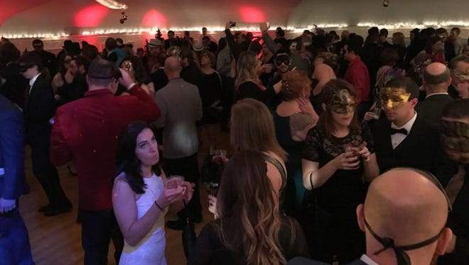 New Year's Eve Masquerade at Roberson Mansion included a variety of music and activities to ring in 2017.
