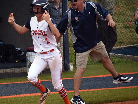 Carson-Newman coach Michael Graves waves Lacie Rinus in after hitting a home run against Lenoir-Rhyne during a game earlier this season.