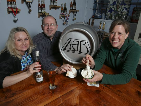"""Liquid Alchemy's Terri Sorantino and Jeffrey Cheskin with Woodside Farm Creamery's Janet Mitchell and their collaboration, """"Espresso Yourself"""" coffee chocolate chip ice cream with the meadery's Ground & Tapped mead."""
