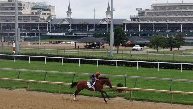 Keen Ice, with Tammy Fox up, at the start of his workout Wednesday at Churchill Downs.