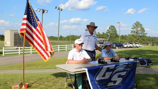 Mickey Burke (left) and Neal Sellers signed letters of intent to shoot for Georgia Southern University's shotgun team on Saturday at Pinetucky Gun Club. The 2020 Aquinas High School graduates were joined by Marty Fischer, the team's head coach.
