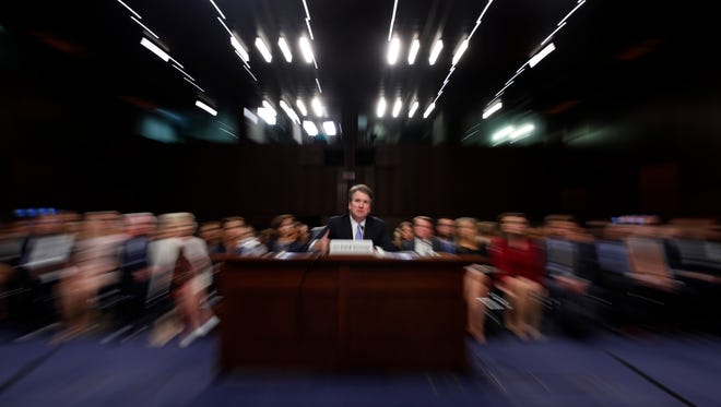 In this photo taken with a slow shutter speed and a zoom, President Donald Trump's Supreme Court nominee, Brett Kavanaugh testifies before the Senate Judiciary Committee on Capitol Hill in Washington, Thursday, Sept. 6, 2018, for the third day of his confirmation hearing to replace retired Justice Anthony Kennedy. (AP Photo/Alex Brandon) ORG XMIT: DCAB133