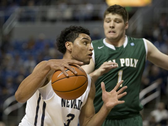Nevada's AJ West drives past Cal Poly's Aleks Abrams at Lawlor Events Center on November 15, 2014.