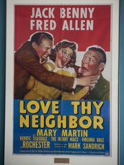 A movie poster for 'Love Thy Neighbor' which was the