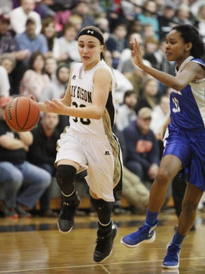 Buffalo Gap's Destiny Harper drives the ball down court as Brunswick's Taijah Bradley guards during the first half of the quarterfinal game at Buffalo Gap on Tuesday, Feb. 23, 2016.