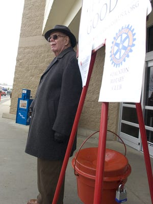 Richard Hamrick of the Staunton Rotary Club rings the bell as he keeps watch over the Salvation Army kettle outside Wal-Mart in Staunton on Wednesday, Dec. 18, 2007.