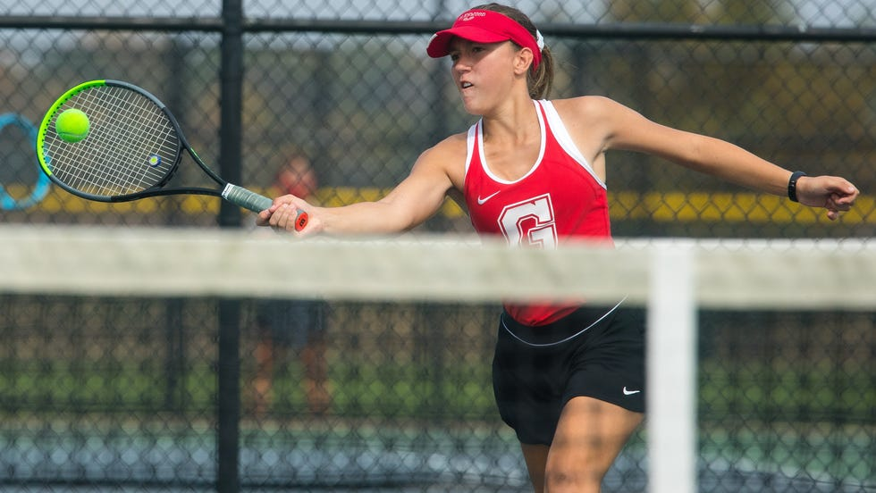 Amber Ehrlich returns the ball as she and Simmi Mander defeat U-High to claim the doubles title during the 2020 Girls CS8 Tennis Tournament at Glenwood High School Saturday, Oct. 10, 2020.