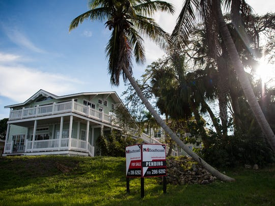 """Steven Vitale, owner of the Old Colorado Inn, has an agreement to buy the 100-year-old house at 41 S.W. Seminole Street — known as the the Dianne Browning Davant historic house, seen here Dec. 14, 2017 — and move it nearby to a row of historic Seminole Street buildings he rents as vacation homes. Developer John Doyle plans to build the """"limited-edition, luxury"""" Seminole Bluff condominium complex in its place."""