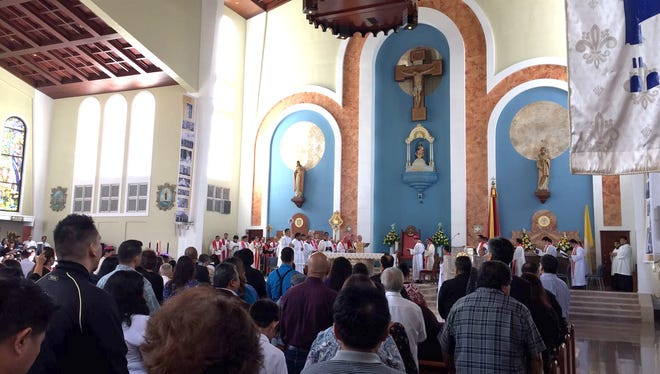 Pews are packed at the Dulce Nombre de Maria Cathedral-Basilica in Hagåtña for a welcoming prayer service for Archbishop Michael Byrnes, Wednesday.