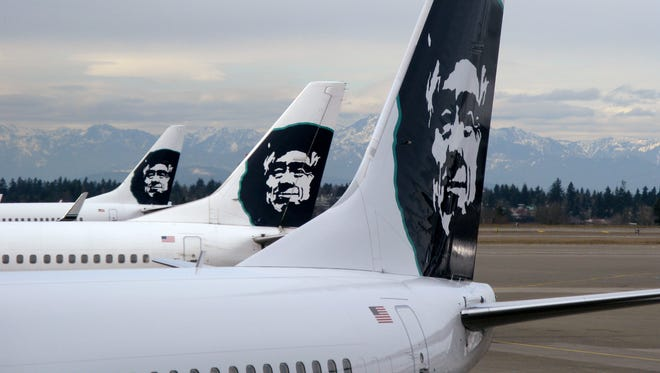 Alaska Airlines planes sit at Seattle-Tacoma International Airport.