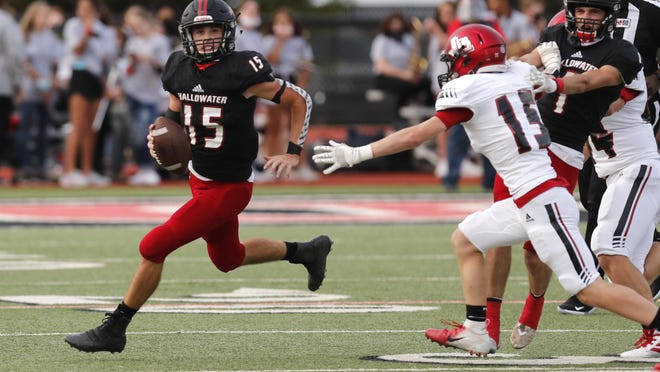 Shallowater quarterback Bax Townsend (15) looks for an open receiver while being chased by Levelland's Blake Klose (15) during the first quarter of the Week Three game on Sept. 11 at Todd Field in Shallowater.