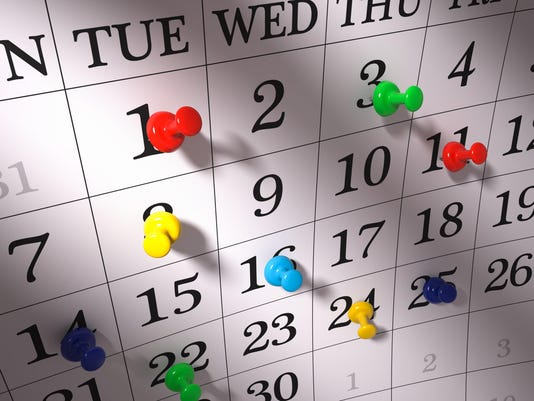 Calendar with pushpins