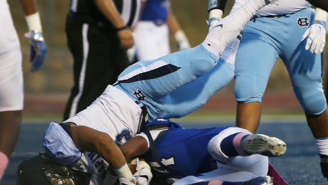 Chapin's Angel Soto crashes into the end zone for a touchdown as he and Bowie's Juan Rojas fought for the ball during the first quarter Thursday at Bowie.