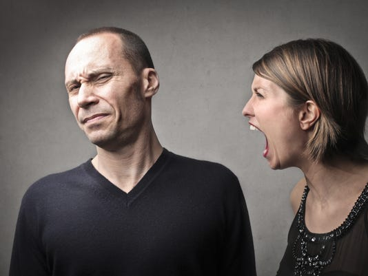 Woman angrily shouting at a man while he is disgusted