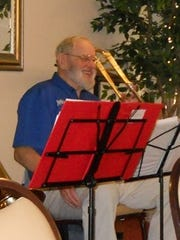 John Lawson plays the trombone with Joyful Noise, a band that visited nursing homes.