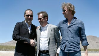 Happier times: Shervin Pishevar, left, celebrates the successful demo of Hyperloop One's technology outside of Las Vegas in May. At right is co-founder and CTO Brogan BamBrogan, who left the company after filing a lawsuit claiming that Pishevar and other company leaders were mismanaging the company. In the center is CEO Rob Lloyd.