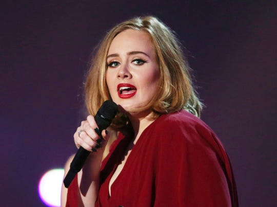 In this Feb. 24, 2016 file photo shows Adele onstage at the Brit Awards 2016 at the 02 Arena in London. Adele, who has five Grammy nominations, announced Tuesday, Dec. 6, including album, song and record of the year.