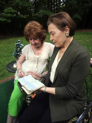 Jane Lavers of Airmont, left, sits with Robin Cutler at Lavers'  home as they look at a diary that belonged to Cutler's mother Jane Hall Aug. 18, 2016. Lavers found the diary in a burned out mansion in Suffern in 1965. Lavers held onto the diary for decades until she was able to return it to Cutler. Cutler has written a memoir about her mother, who's diary chronicled her life in Hollywood during the 1930's.