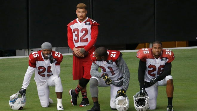 Former LSU star defender Tyrann Mathieu (32) watches from the sidelines ready to return to the Arizona Cardinals.
