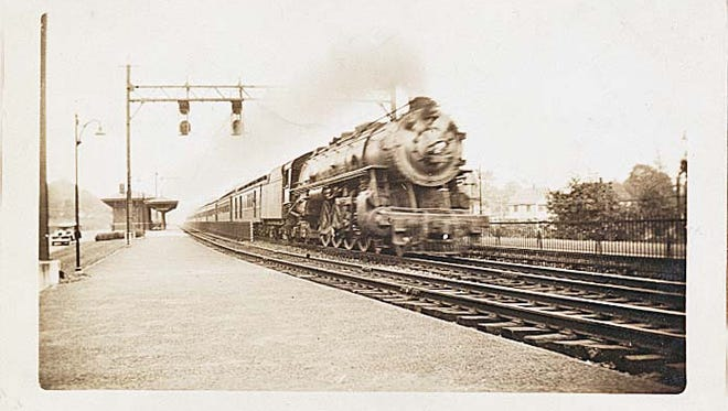 The Chicago Limited races past the train station in Millburn in this 1932 photograph.