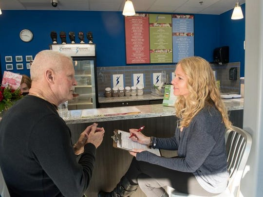 Nutritionist Kim Garrity, right, advises member Bob Higgins at Eastpointe Health & Fitness in Atlantic Highlands.