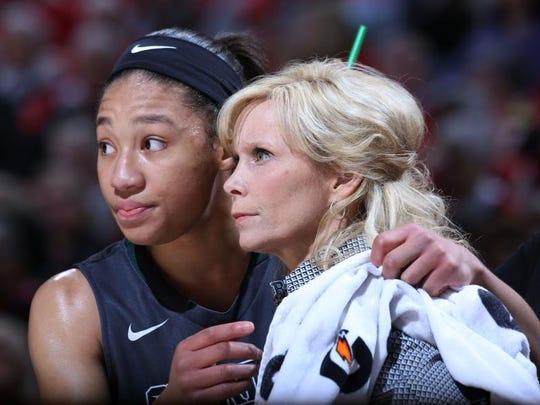 Michigan State Spartans guard Aerial Powers (23) talks to coach Suzy Merchant in a game against the Ohio State Buckeyes during the women's Big Ten Conference tournament at Bankers Life Fieldhouse. Michigan State Spartans defeats Ohio State 82-63.