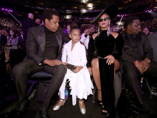 Jay-Z, Blue Ivy and Beyonce Knowles attend the 60th