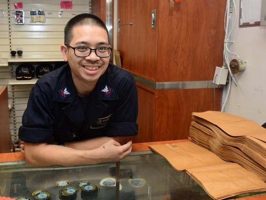 Ship's Serviceman Gary Luu, from Portland, Ore.,