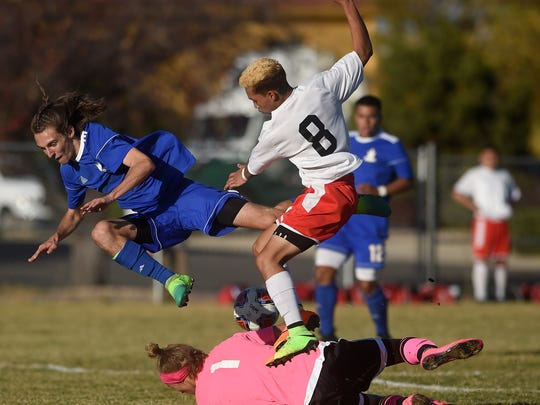 Reed goalie Hunter Ehlers makes a save while taking on Wooster during their soccer game in Reno on Oct. 31.