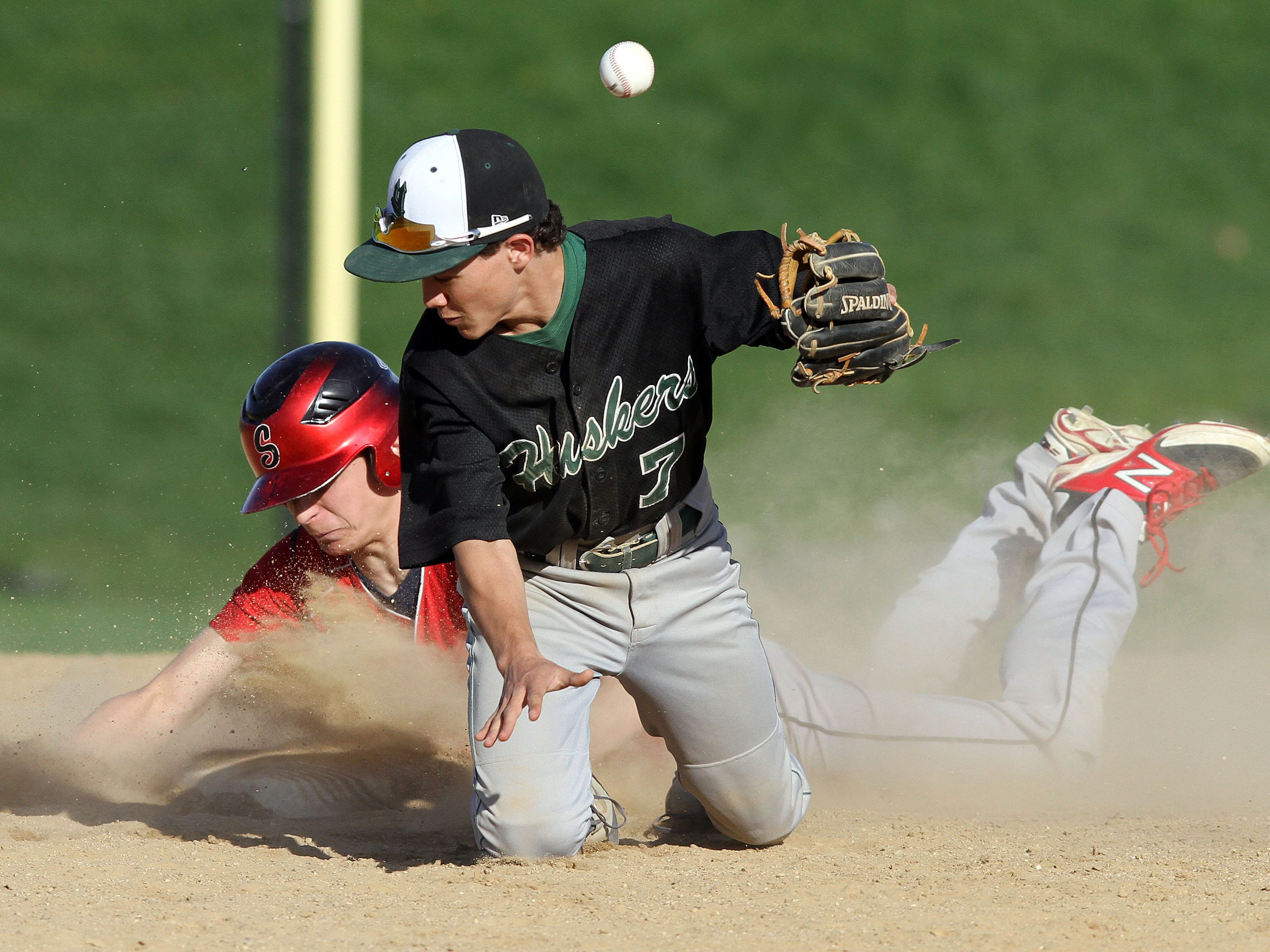 Yorktown's Jake Bichler (7) can't handle the throw as Somers Mike Acocella (10) slides safe into second with a stolen base during a baseball game at Somers High School April 29, 2015. Somers won the game 7-5.