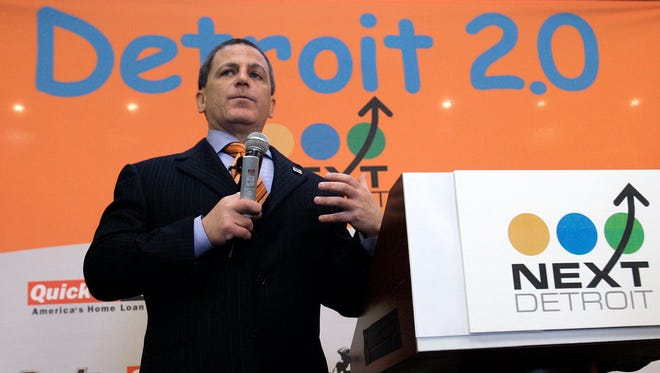 Quicken Loans founder and chairman Dan Gilbert announces he is relocating its corporate offices and 4,000 jobs from the suburbs to Detroit during a news conference in Detroit, Nov. 13, 2007.