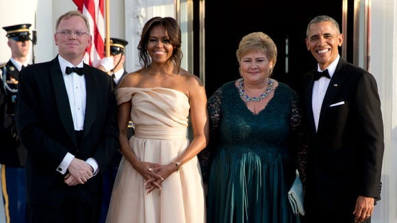 President Obama and Michelle Obama greet Norwegian