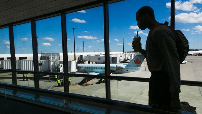 May 1, 2017 - A traveler rides on a moving walkway shortly after the first Air Canada flight from Toronto to Memphis landed at the Memphis International Airport on Monday. The regular schedule international air service returned after a five-year absence.