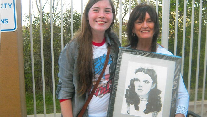 """Bailey Wheeler, of Buffalo Gap, gives a portrait she made of Dorothy from """"The Wizard of Oz"""" to her aunt, Vicki Langston-Branson."""
